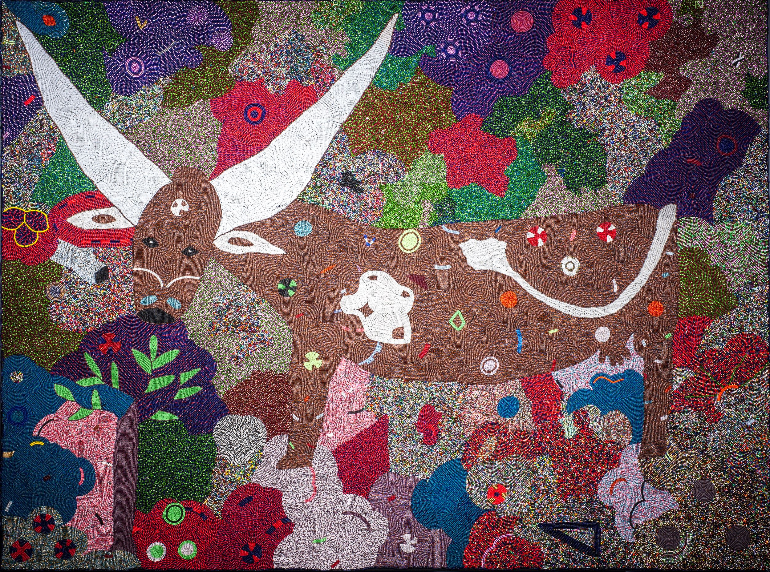 An abstracted image of a brown bull made out of beads sewn onto fabric. The bull is surrounded by br