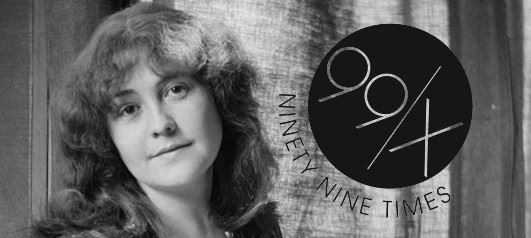 Black and white photograph of Rose O'Neill with a black 99x logo