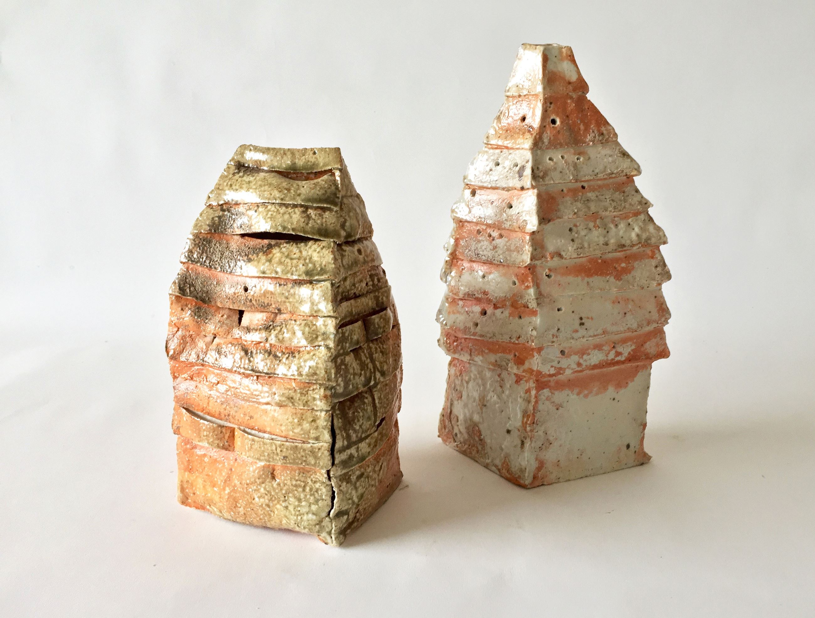 two ceramic houses fired with pale orange glazes